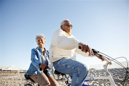 Seniors Riding Tandem Bicycle at Beach, Santa Monica Pier, Santa Monica, California, USA Stock Photo - Rights-Managed, Code: 700-02125695