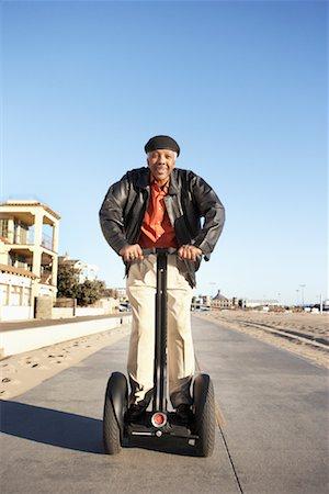 Man Riding Segway at Beach, Santa Monica Pier, Santa Monica, California, USA Stock Photo - Rights-Managed, Code: 700-02125697