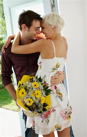 flower greeting - Couple Embracing in Doorway Stock Photo - Rights-Managed, Code: 700-02129036