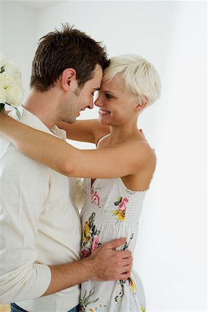flower greeting - Young Couple Embracing Stock Photo - Rights-Managed, Code: 700-02129037