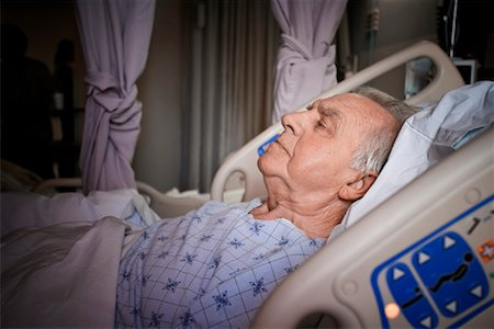 Man Sleeping in Hospital Bed Stock Photo - Rights-Managed, Code: 700-02121241