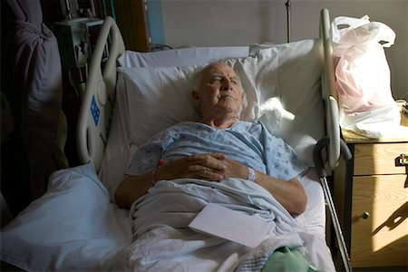Man Lying in Hospital Bed Stock Photo - Rights-Managed, Code: 700-02121242