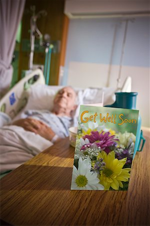 Elderly Man in Hospital with Get Well Soon Card on Table Stock Photo - Rights-Managed, Code: 700-02121243