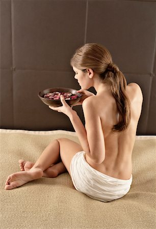 Rear View of Woman Holding Bowl of Flower Petals Stock Photo - Rights-Managed, Code: 700-02121379