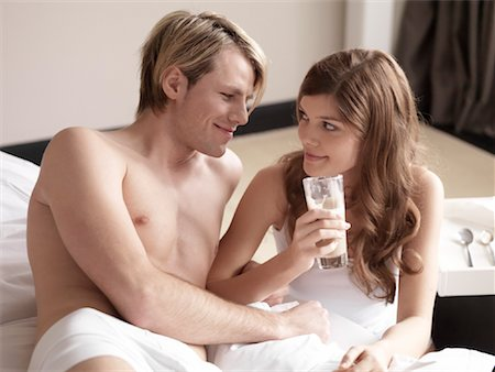 sexually aroused woman - Couple Having Coffee in Bed Stock Photo - Rights-Managed, Code: 700-02121419