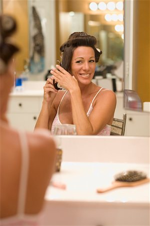 Woman Styling Her Hair Stock Photo - Rights-Managed, Code: 700-02130226