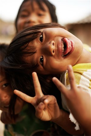 preteens fingering - Portrait of Children Making Peace Signs, Fang, Thailand Stock Photo - Rights-Managed, Code: 700-02156740