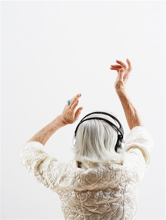 Woman Listening to Headphones Stock Photo - Rights-Managed, Code: 700-02199991