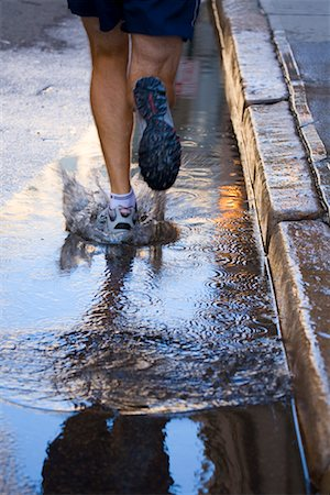 Man Running on Wet Road, Providence, Rhode Island, USA Stock Photo - Rights-Managed, Code: 700-02200347