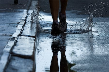 Man Running on Wet Road, Providence, Rhode Island, USA Stock Photo - Rights-Managed, Code: 700-02200350