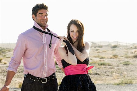 desert people dress photos - Woman Grabbing Man's Tie Stock Photo - Rights-Managed, Code: 700-02217047