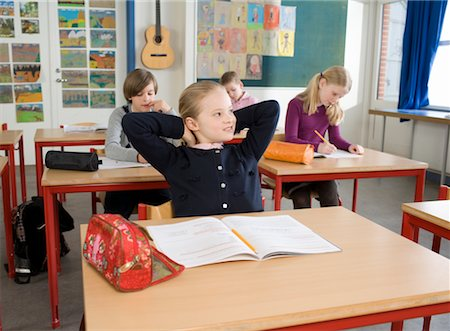 photo of class with misbehaving kids - Girl with Schoolwork in Classroom Stock Photo - Rights-Managed, Code: 700-02217465