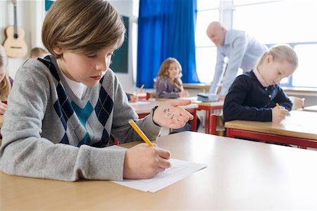 photo of class with misbehaving kids - Boy Cheating on Test Stock Photo - Rights-Managed, Code: 700-02217493