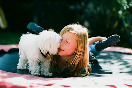 preteen kissing - Girl with Dog on Trampoline, Costa Mesa, California, USA Stock Photo - Rights-Managed, Code: 700-02217529