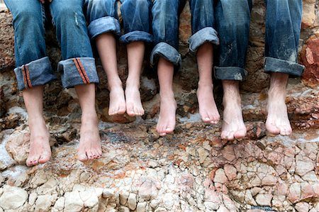 Family Sitting on Rocks at the Beach, Mallorca, Spain Stock Photo - Rights-Managed, Code: 700-02235838