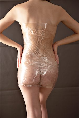 Woman Wrapped in Plastic Wrap Stock Photo - Rights-Managed, Code: 700-02245034