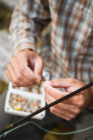 Man Tying Fishing Fly, Yosemite National Park, California, USA Stock Photo - Rights-Managed, Code: 700-02245501