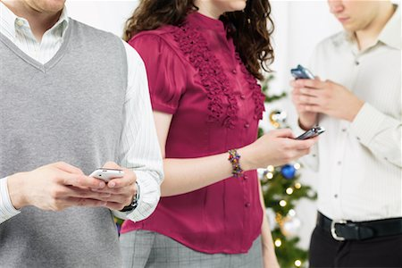 Group of People at Christmas Party Sending Text Messages Stock Photo - Rights-Managed, Code: 700-02264267