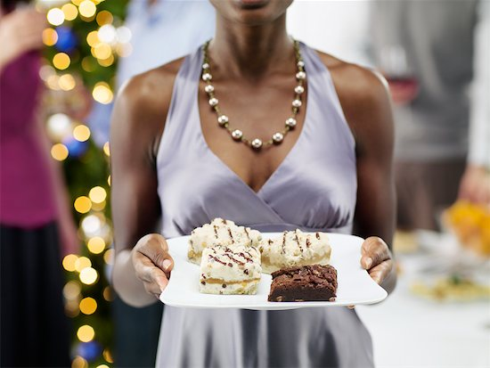 Close-up of Woman Holding Tray of Desserts at Christmas Party Stock Photo - Premium Rights-Managed, Artist: Matthew Plexman, Image code: 700-02264272