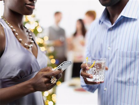 Couple at Christmas Party, Woman Sending Text Messages Stock Photo - Rights-Managed, Code: 700-02264301