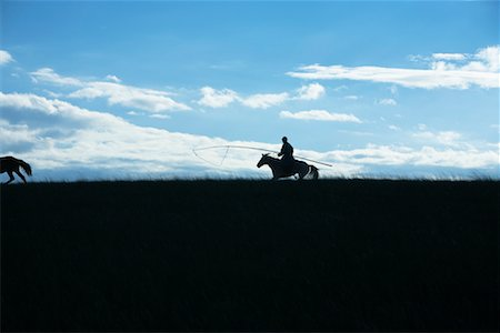 Silhouette of Horsmean Herding Horses, Inner Mongolia, China Stock Photo - Rights-Managed, Code: 700-02264829