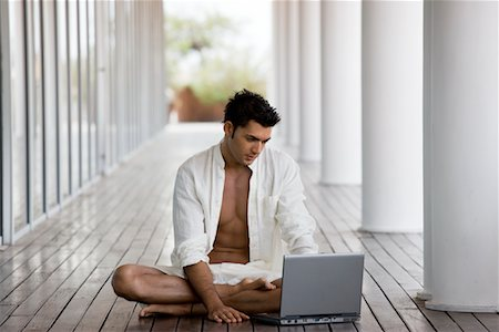 Man Sitting Outdoors, Using Laptop Computer Stock Photo - Rights-Managed, Code: 700-02264901
