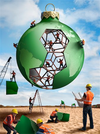 Construction Workers Building a Christmas Ornament Globe Stock Photo - Rights-Managed, Code: 700-02264965
