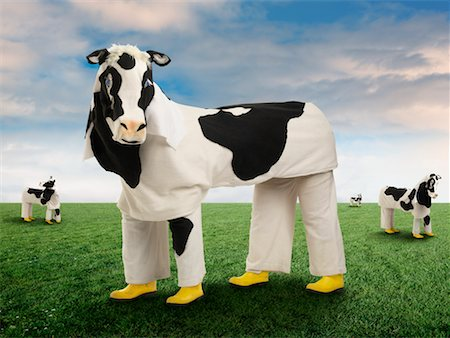 People Wearing Cow Costumes Standing in Pasture Stock Photo - Rights-Managed, Code: 700-02264979