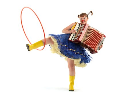 Portrait of a Clown Playing an Accordion and Spinning a Hula Hoop With Her Leg Stock Photo - Rights-Managed, Code: 700-02265021