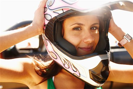 Woman Wearing Racing Helmet Stock Photo - Rights-Managed, Code: 700-02265428