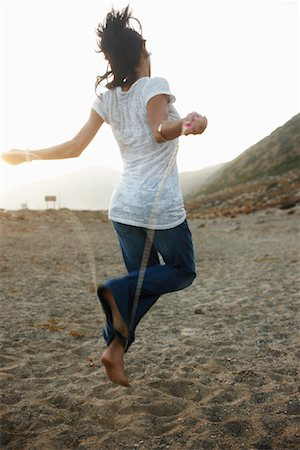 Woman Skipping on Beach Stock Photo - Rights-Managed, Code: 700-02265422