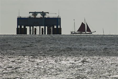 Flat-Bottomed Sailboat Near Offshore Platform, Wadden Sea, Friesland, Netherlands Stock Photo - Rights-Managed, Code: 700-02265779