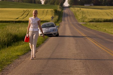 stalled car - Woman Walking Along Country Road, Carrying Gas Can Stock Photo - Rights-Managed, Code: 700-02260106