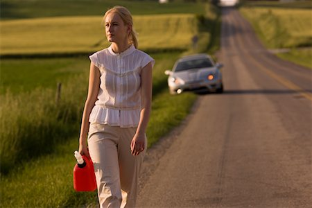 stalled car - Woman Walking Along Country Road, Carrying Gas Can Stock Photo - Rights-Managed, Code: 700-02260107