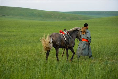 Horseman Walking with Horse, Inner Mongolia, China Stock Photo - Rights-Managed, Code: 700-02263889