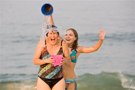 Daughter Pouring Pail of Water on Mother's Head at the Beach, New Jersey, USA Stock Photo - Rights-Managed, Code: 700-02263990