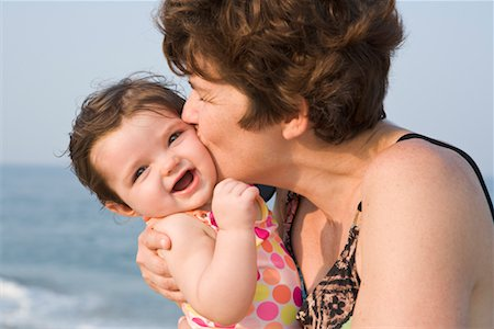 Mother Kissing Baby Girl at the Beach, New Jersey, USA Stock Photo - Rights-Managed, Code: 700-02263991