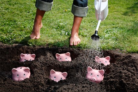 Woman Watering Piggy Banks Stock Photo - Rights-Managed, Code: 700-02289304