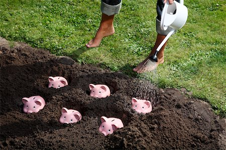 Woman Watering Piggy Banks Stock Photo - Rights-Managed, Code: 700-02289305