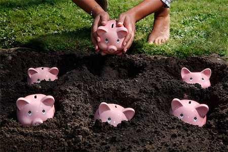 Piggy Banks Planted in Dirt Stock Photo - Rights-Managed, Code: 700-02289308