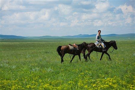 Horseman Leading Horse, Inner Mongolia, China Stock Photo - Rights-Managed, Code: 700-02314934