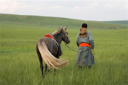Horseman Walking with Horse, Inner Mongolia, China Stock Photo - Rights-Managed, Code: 700-02314933