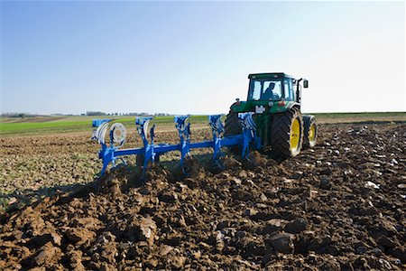 plow - Tractor Tilling the Soil Stock Photo - Rights-Managed, Code: 700-02315079