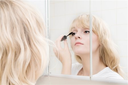 Woman Applying Mascara Stock Photo - Rights-Managed, Code: 700-02345967