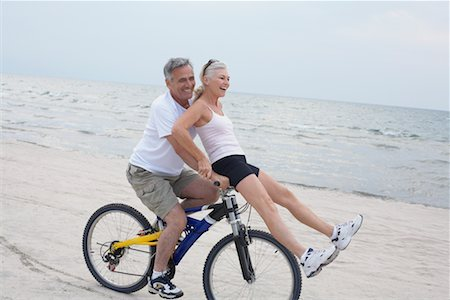 Couple Riding Bike on the Beach, Elmvale, Ontario, Canada Stock Photo - Rights-Managed, Code: 700-02346558