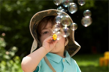 Boy Blowing Bubbles Stock Photo - Rights-Managed, Code: 700-02347734