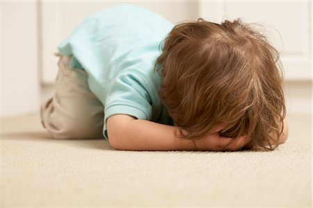 Boy on Floor with Face Covered Stock Photo - Rights-Managed, Code: 700-02347735