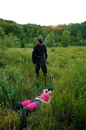 Police Officer Finding Woman's Body in Field, Toronto, Ontario, Canada Stock Photo - Rights-Managed, Code: 700-02348155