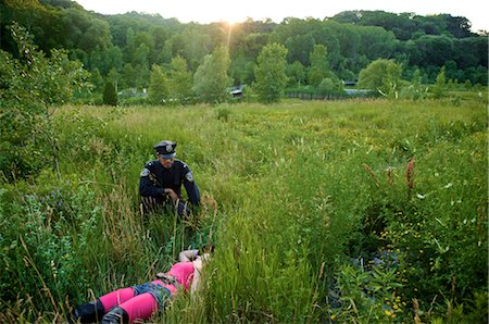 dead female body - Police Officer Finding Woman's Body in Field, Toronto, Ontario, Canada Stock Photo - Rights-Managed, Code: 700-02348156