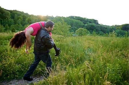 Man Carrying Woman's Body into Field, Toronto, Ontario, Canada Stock Photo - Rights-Managed, Code: 700-02348157